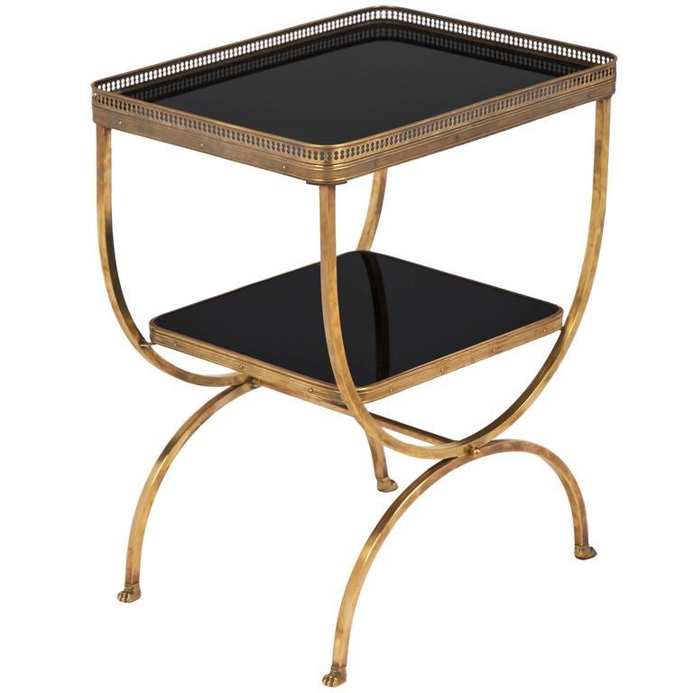 Vintage brass curule side table with black glass shelves