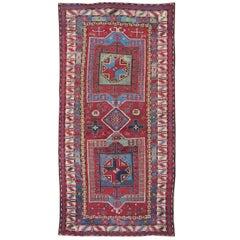 Antique Caucasus Kazak Carpet with Dual Geometric Medallions