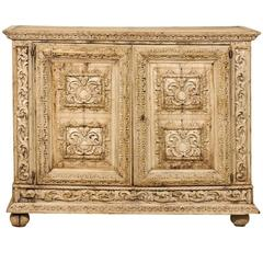 An Italian 18th Century Two-Door Bleached Wood Credenza Richly Carved with Age