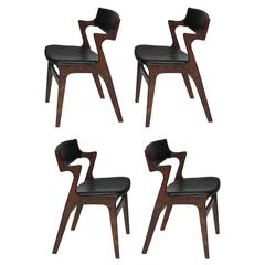 Four Danish Rosewood and Black Leather Dining Chairs