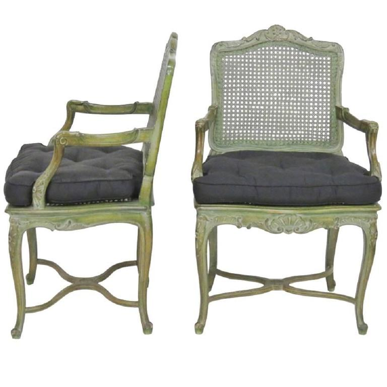 Pair of French Louis XVI Style Green Painted Caned Armchairs