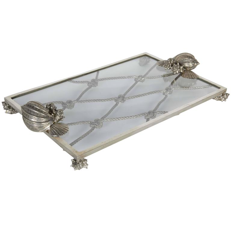 Exquisite pewter and glass serving tray with nautical theme.  All handcrafted pewter frame with glass top, featuring sea shell and knotted rope motifs.  Great addition to any barware set.