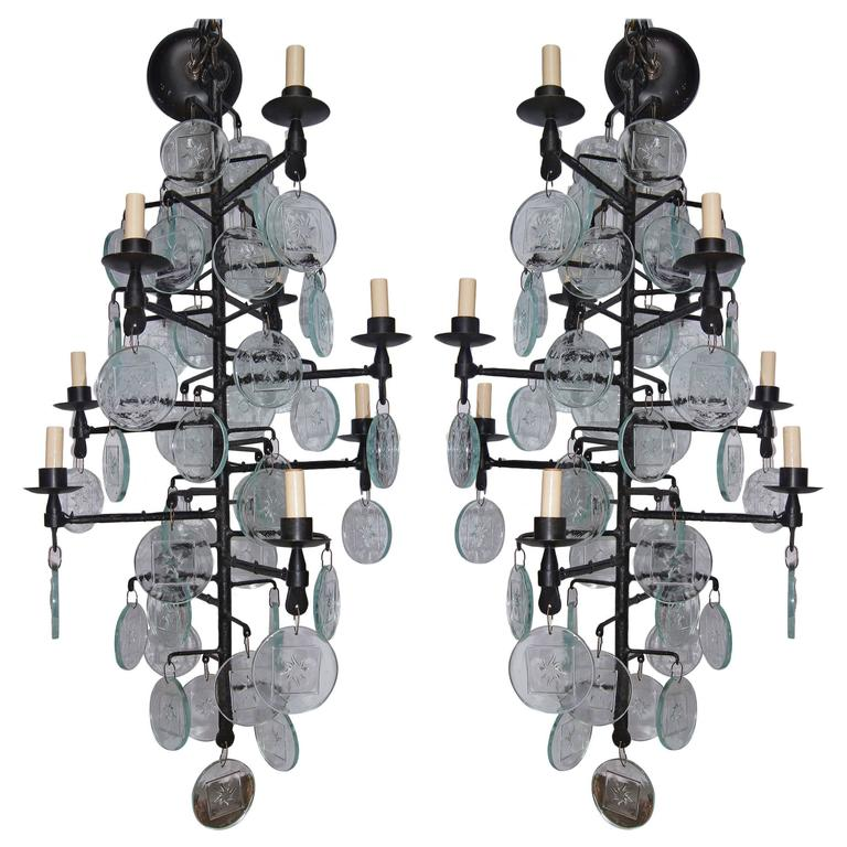 Pair of Wrought Iron and Molded Glass Chandeliers