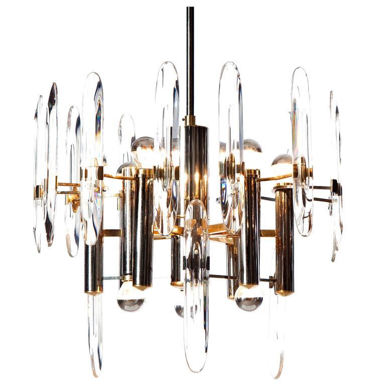 1960s Gaetano Sciolari Nine-Light Chrome, Brass and Crystal Glass Chandelier