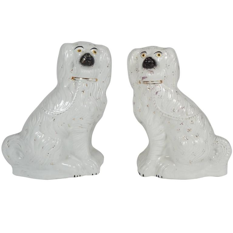 Pair of Similar Staffordshire Porcelain Spaniels For Sale