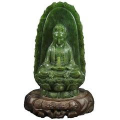 Antique Spinach Green Jade Kwan Yin on Carved Stand