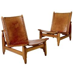 Pair of Saddle-Stitched Leather and Walnut Low Chairs