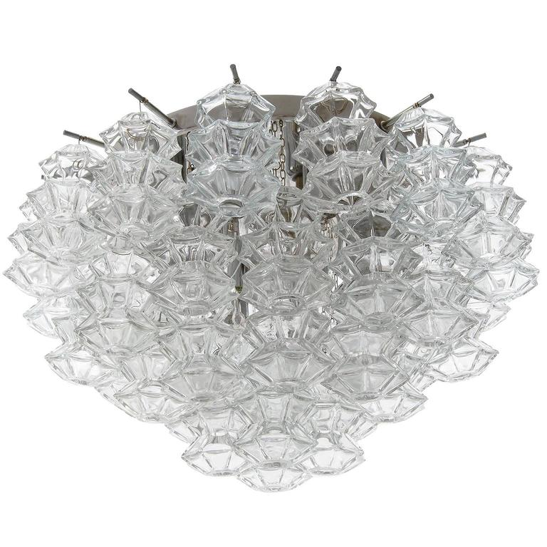 A set of four large flush mount chandeliers