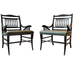 Pair of Anglo-Japanese Ebonized Open Armchairs. Attributed to Jas Shoolbred