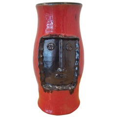 Red Vase with Black Relied Head, by Cloutier Brothers