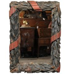 French 1870s Large Black Forest Wood Carved Mirror with Painted Tied Leaves