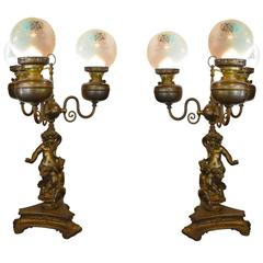 Pair of Antique Cherub Oil Lamps Converted to Electric