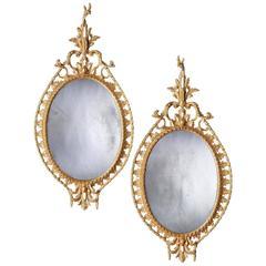 Pair of George III Oval Giltwood Mirrors