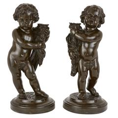 Pair of Patinated Bronze Cherubs, After Clodion