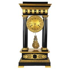 Early 19th Century Magnificent Gilt and Ebony French Empire Portico Clock