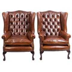 Pair of Leather Ball and Claw Wing Chairs Armchairs