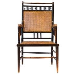 E W Godwin. An Anglo-Japanese Ebonized Beech and Caned Armchair