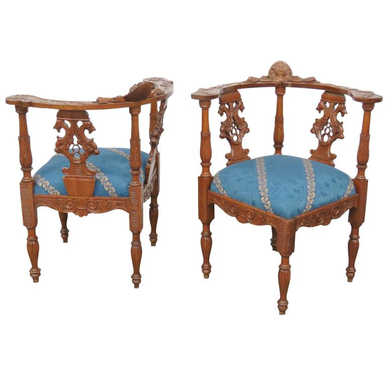 Pair of Carved Side Chairs with Cherubs