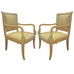Pair of Armchairs with Carved Dolphin Head Hand Rests.