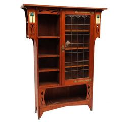 Arts and Crafts Oak Glazed Bookcase with inset period tiles