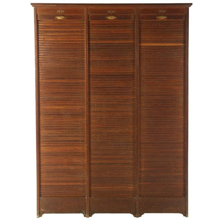 Charmant French Roll Top Cabinet, Circa 1910 Having Three Vertical Tambour Doors For  Sale