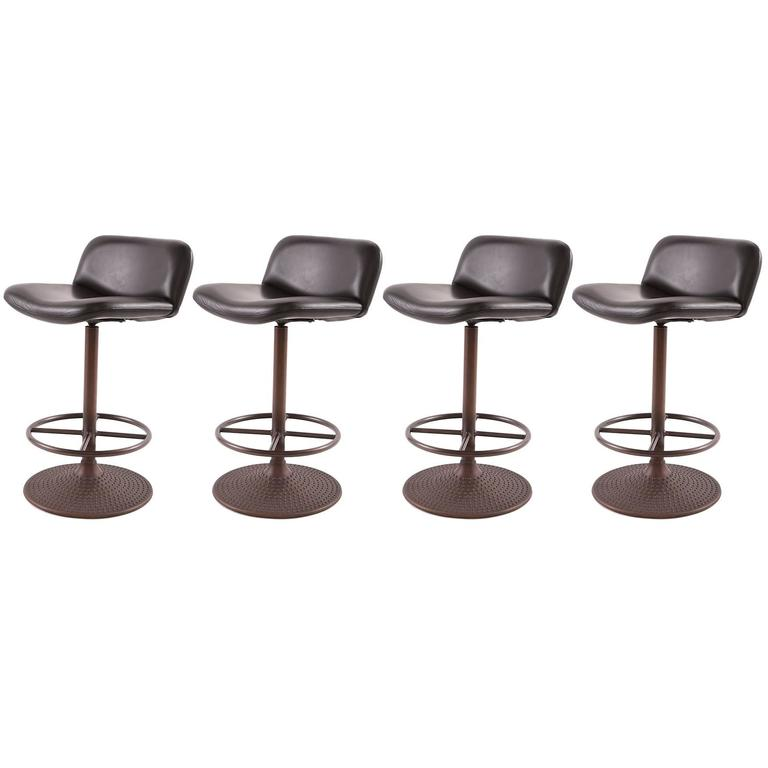 Four Caribe Leather And Bronze Counter Stools By