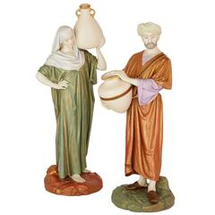 Pair of Orientalist Royal Worcester Porcelain Figures of Water Carriers