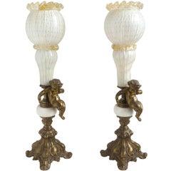 Murano White Gold Flecks Italian Art Glass, Marble, Brass Cherub Torch Lamps