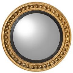 English, Gilt Gold and Black Regency Round Convex Mirror, circa 1820s
