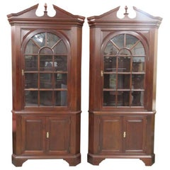 Pair of Stickley Mahogany Lighted Corner Cabinets