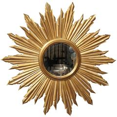 French Mid 20th Century Giltwood Sunburst Mirror with Rays of Varying Sizes
