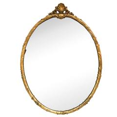 1950s Large Gilt Carved Shell Crest Oval Mirror by Friedman Brothers