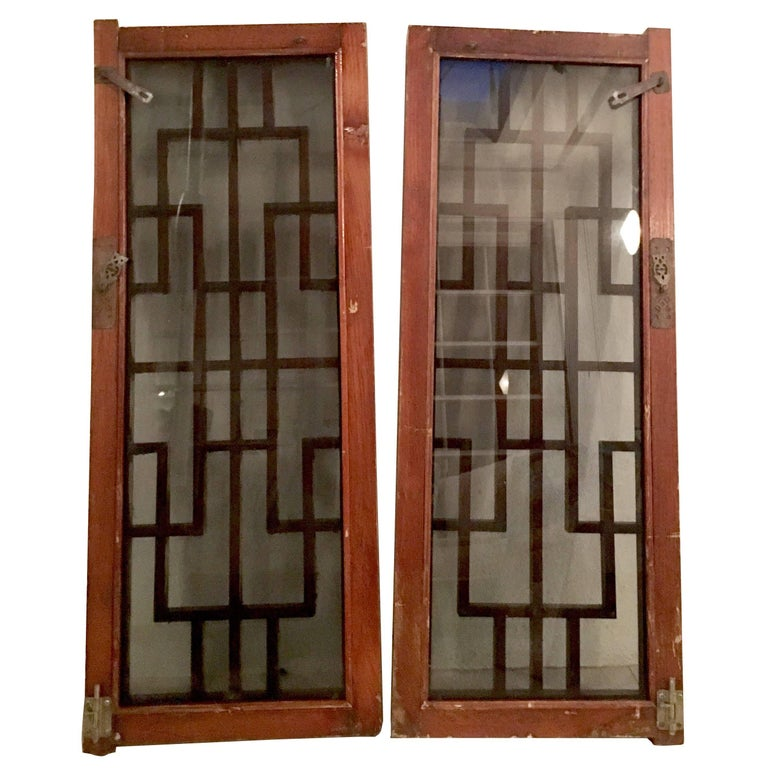 Antique Pair Of Chinese Carved Mahogany and Smoke Glass Windows For Sale