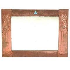 Glasgow School, An Arts & Crafts Hammered Copper Wall Mirror with pomegranates