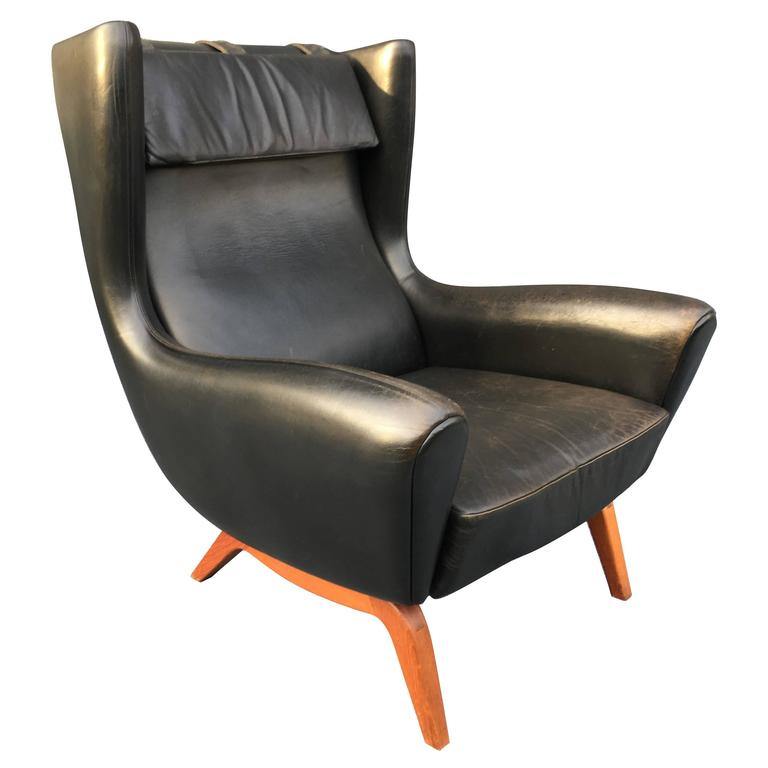 Illum Wikkelso Black Leather and Teak, Model 110 Lounge Chair