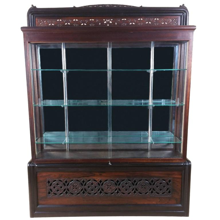 Scottish Carved And Pierced Solid Rosewood And Teak Display Cabinet For Sale