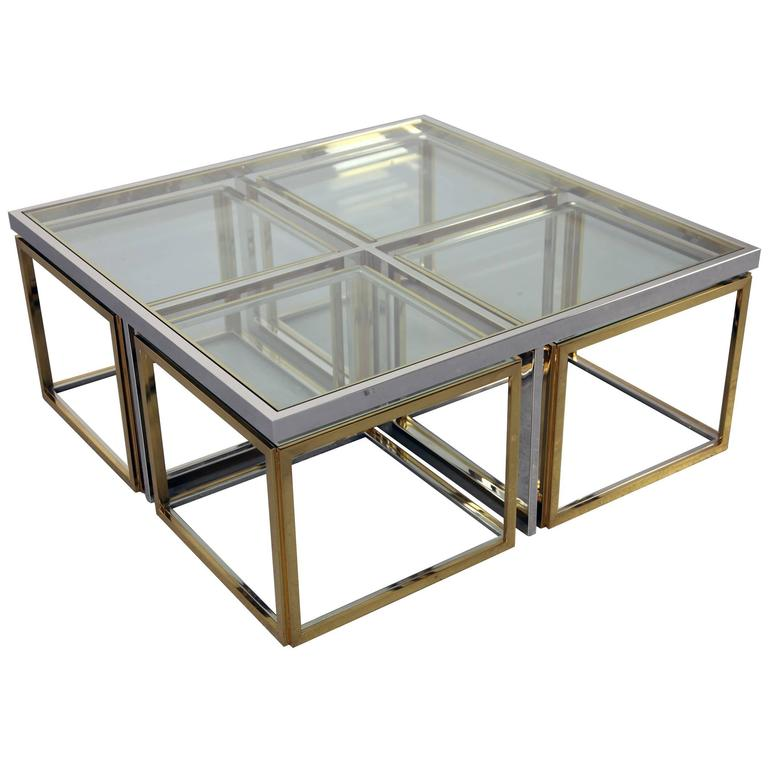 chrome coffee table with four brass nesting tablesmaison