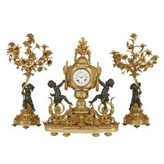 Gilt and Patinated Bronze Antique French Three-Piece Clock Set by Raingo Frères