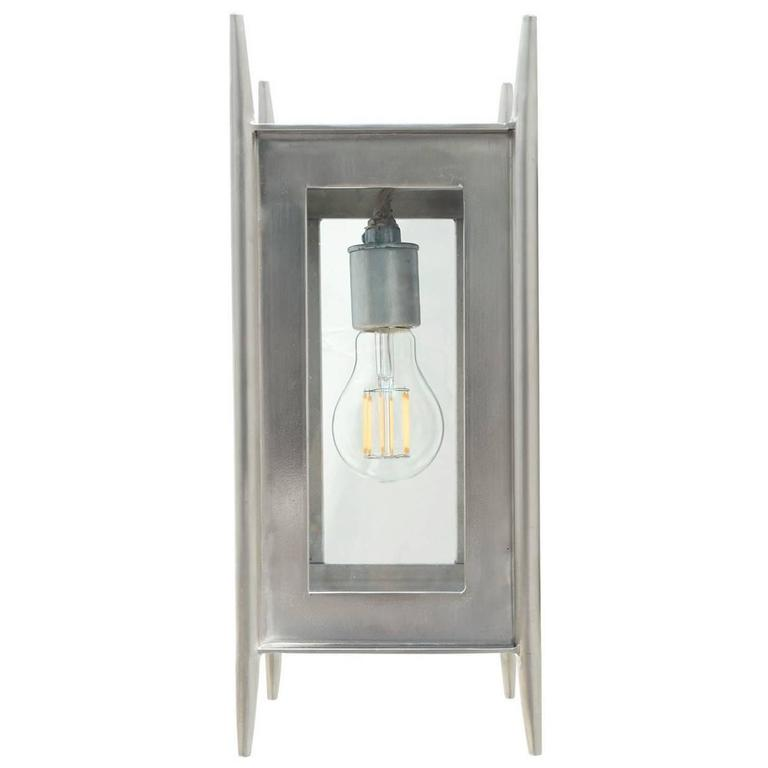 Modern wrought iron brushed nickel wall sconce interior for Interior sconce lighting