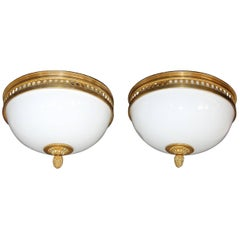 Pair of French Doré Bronze and White Opaline Glass Flush Mount Ceiling Lights