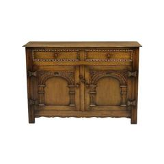 Arts and Craft Style Carved Oak Two-Door Cabinet
