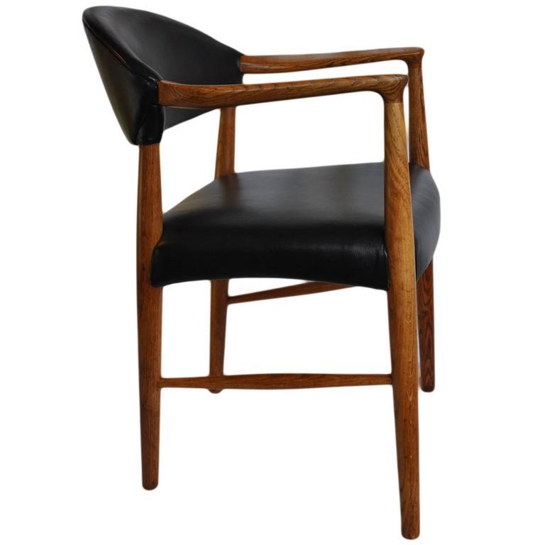 Kurt Olsen chair, fully reupholstered in black leather.
