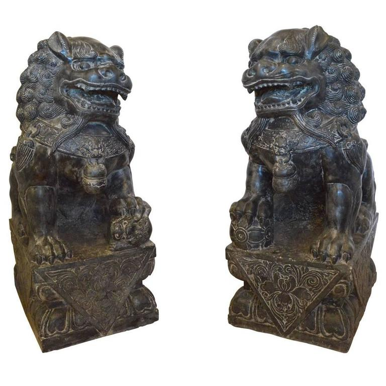 Large carved granite or stone chinese foo dogs at stdibs