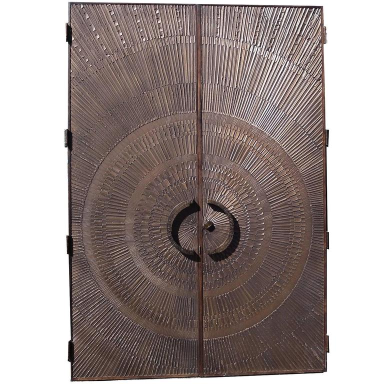 "Massive ""Heroic Sunburst"" Double Sided Bronze Doors by Forms + Surfaces 1"