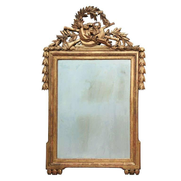 Louis XVI carved and gilded mirror, ca. 1780