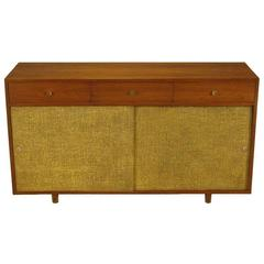 Custom Walnut and Lacquered Linen Sliding Door Nine-Drawer Cabinet