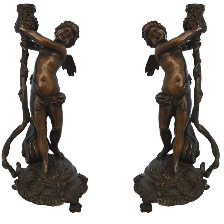 Pair of Tall Bronze Cherub Candleholders
