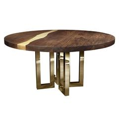 Elegant Round Table Rests on a Gorgeous Series of Brass Legs
