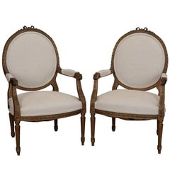 Pair of Louis XVI Oval Back Gilded Frame Fauteuils