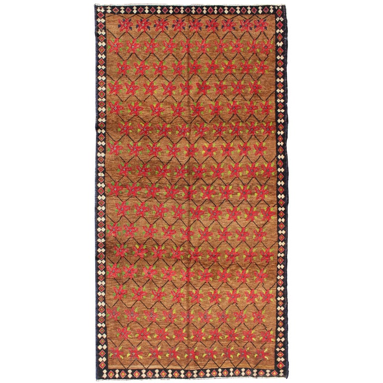 Turkish Oushak Runner with Poinsettia Design Set Atop Light Brown Background